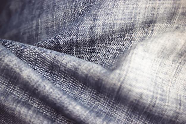 ブルージーンズは、テクスチャの背景を閉じます。ジーンズの背景、水色のナチュラルクリーンデニムの質感。