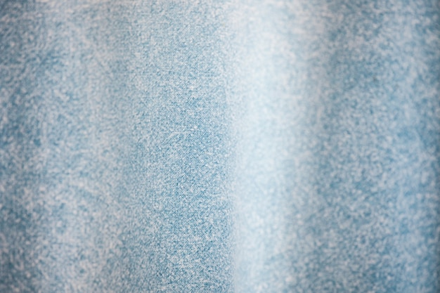 Blue jeans denim fabric with wave texture and background
