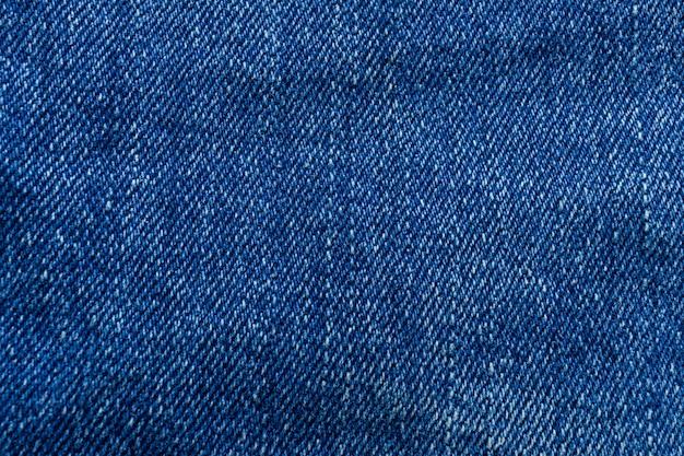 Предпосылка текстуры ткани голубых джинсов.