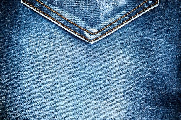 背景とパターンのポケット付きブルージーンズ生地の質感