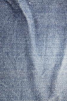 Предпосылка текстуры синих джинсов.