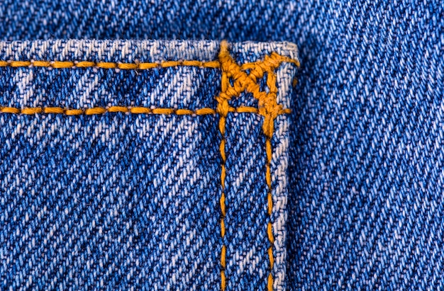 Blue jeans texture fragment closeup
