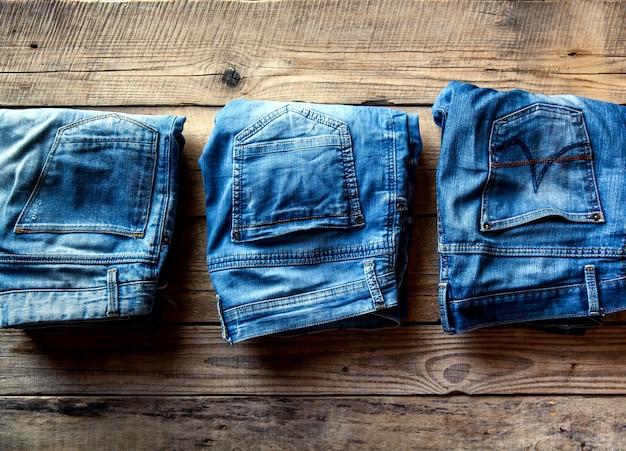 Blue jeans on wooden board.