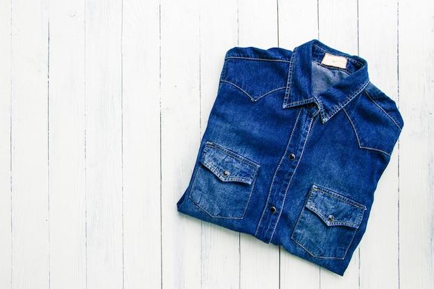 Blue jeans on wooden Premium Photo