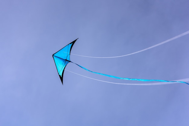 Blue kite floating in the blue sky kite with blue sky background
