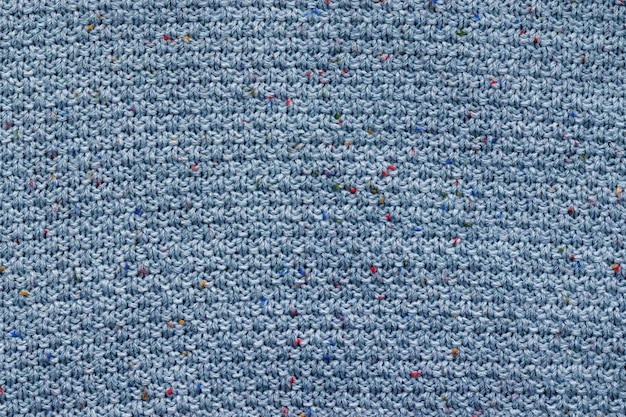 Blue knitted fabric texture. rough sweater background