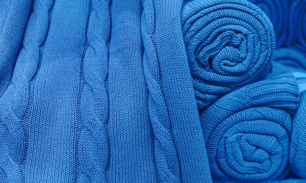Blue knitted fabric twisted into a roll