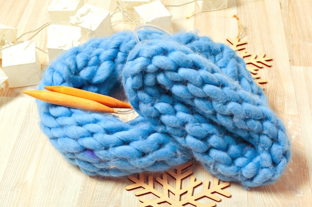 Blue knitted hat in composition