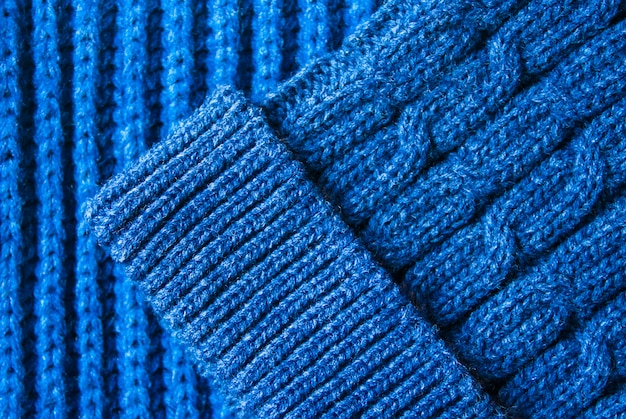Blue knitted scarf and hat. autumn and winter warm clothes concept.