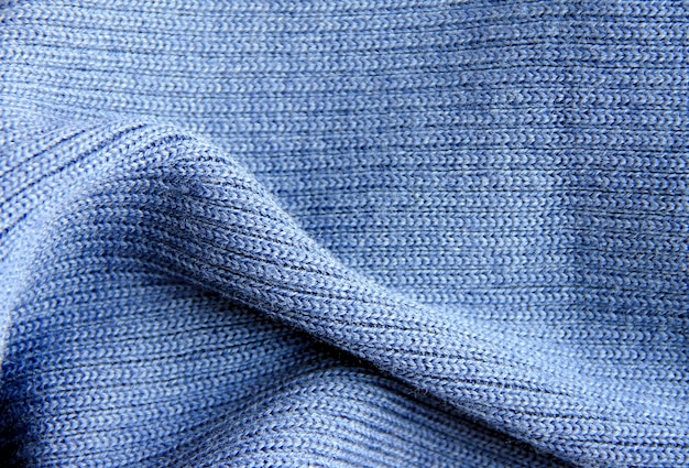 Blue knitted wool fabric can be used as background and texture