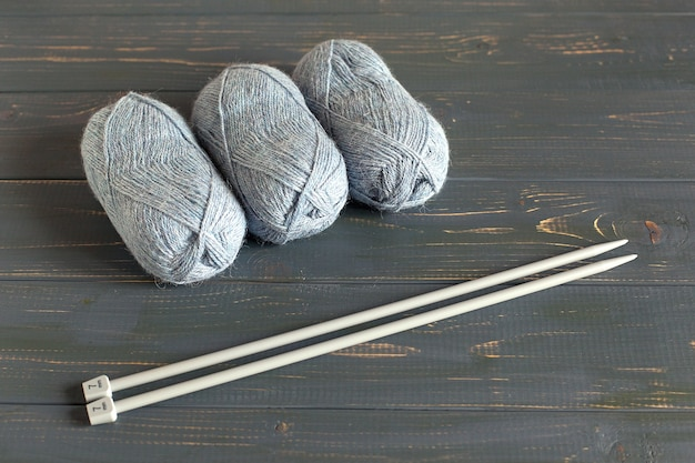 Blue knitting wool and knitting needles.