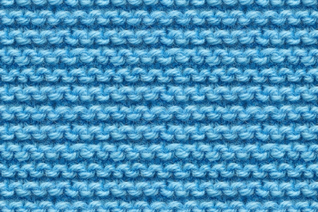 Blue knitwear fabric texture. knitting texture macro snapshot. blue knitted