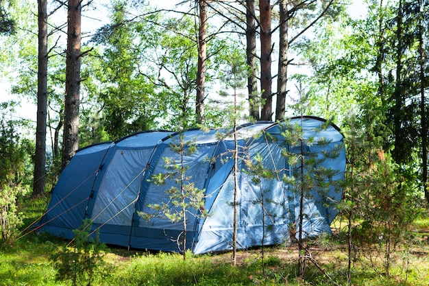 Blue large four-seater camping tent. summer camp, rest, hike.