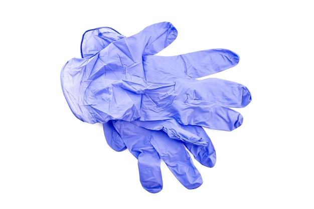흰색 배경에 고립 된 블루 라텍스 의료 장갑 프리미엄 사진