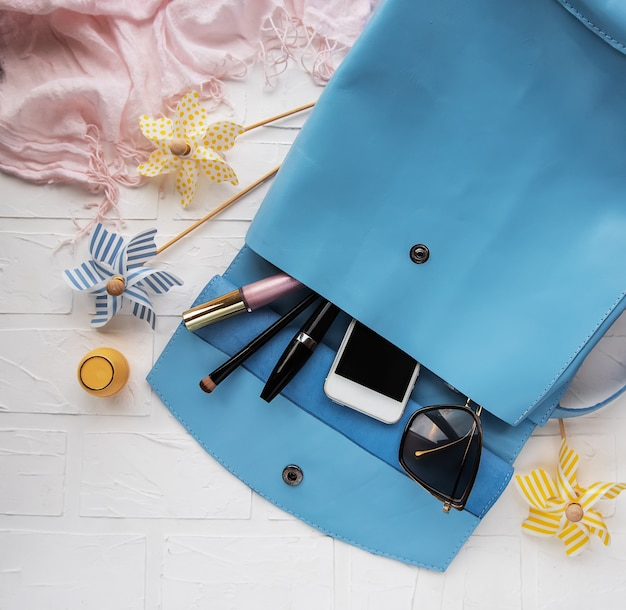 Blue leather backpack with  accessories