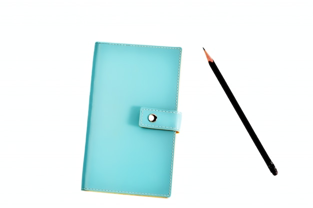 Blue leather organizer with pencil