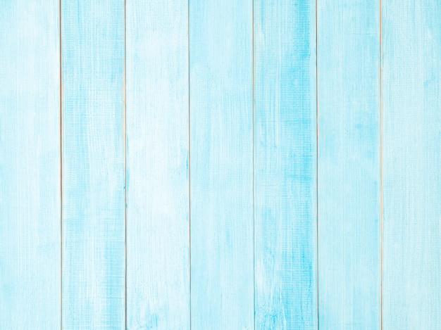 青い光の木製のテクスチャまたは壁。パステルブルーの木製テーブル。