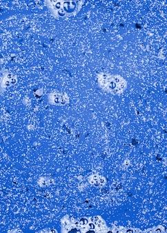 Blue liquid withgrey crumbs