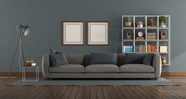 Синяя гостиная с современным диваном и книжным шкафом на фоне