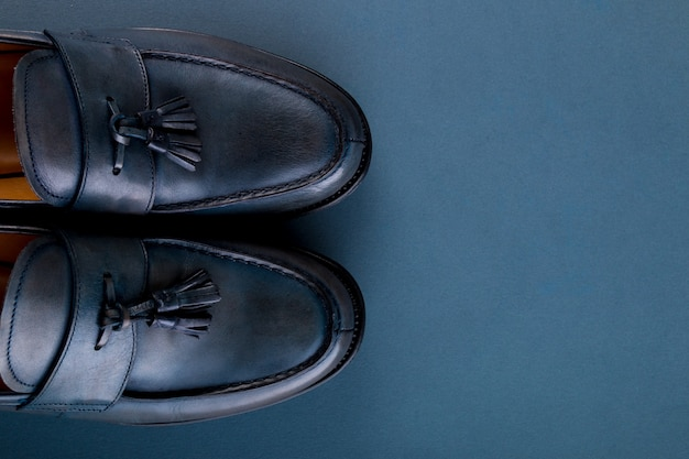 Blue loafer shoes on blue surface