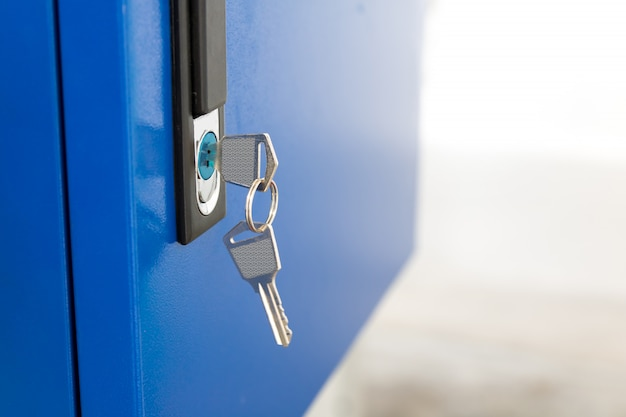 Blue locker and key chain in school gym.
