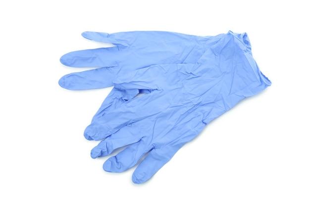 白い孤立した背景に分離された青い医療用手袋