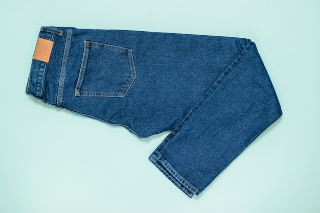 Blue men's jeans. fashionable denim men's clothing. flat lay. the view from the top.