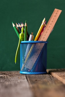 Blue metal container with school supplies