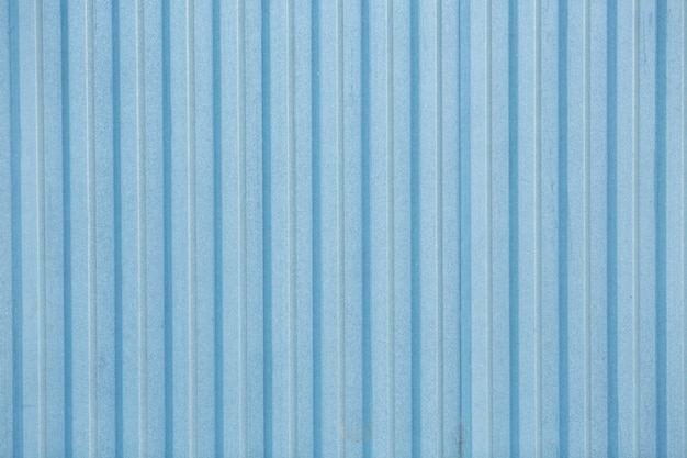 Blue metal fence in industry area. vintage old turquoise fencing texture