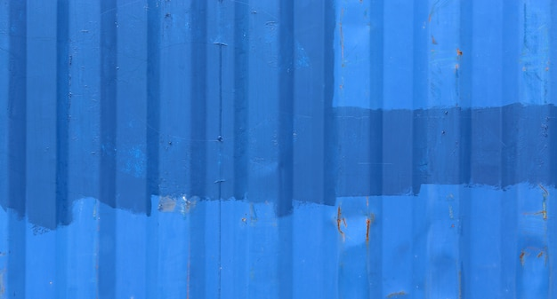 Blue metal wall of a old cargo container