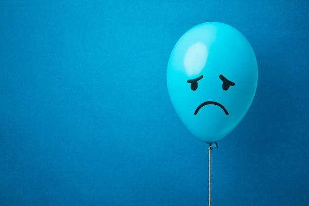 A blue monday balloon on a blue background