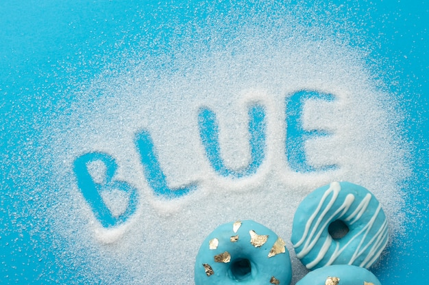Blue monday composition with doughnuts