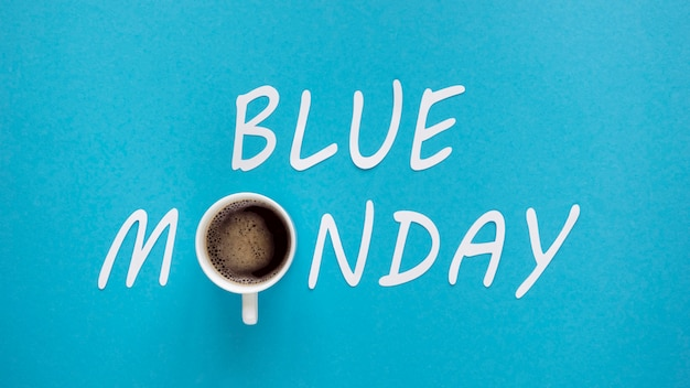Blue monday concept with cup of coffee