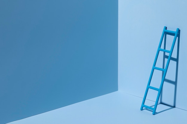 Blue monday with ladder and copy space