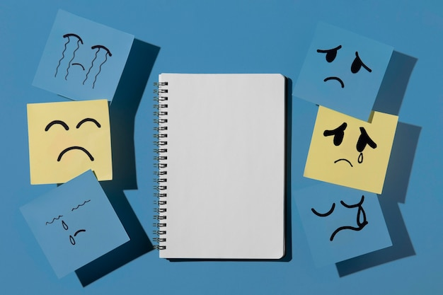 Blue monday with sticky notes and notebook