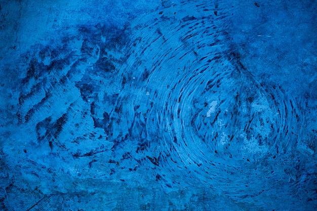 青いモルタルの背景、セメントの質感