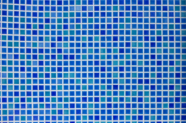 Blue mosaic background. multi-colored blue mosaic tiles at the bottom of the pool
