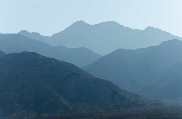 Blue mountain ranges silhouettes with tonal perspective