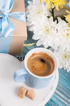 Blue mug of black coffee