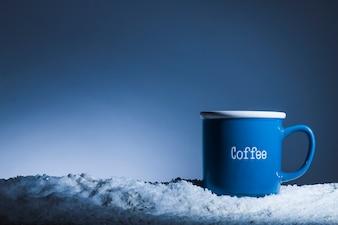 Blue mug on bank of snow