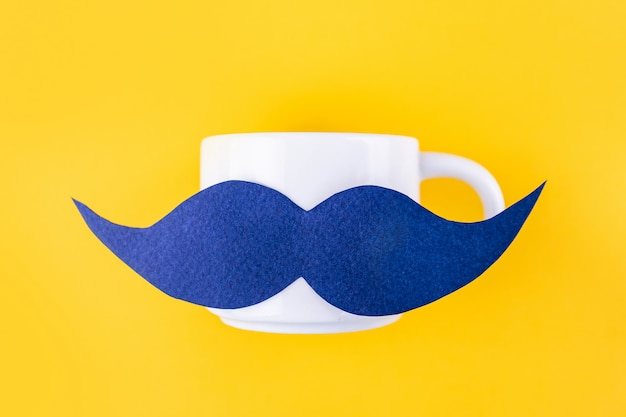 Blue mustache on a coffee mug for movember concept