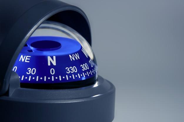 Blue nautical compass close up