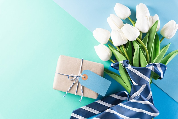 Blue necktie, gift box and greeting card
