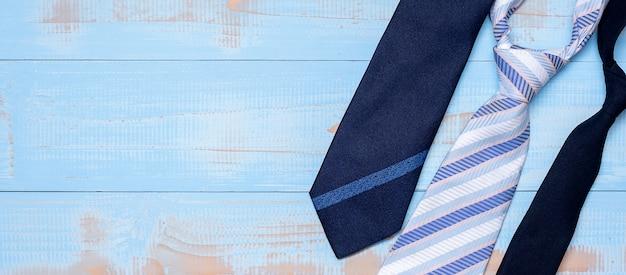 Blue necktie on wood