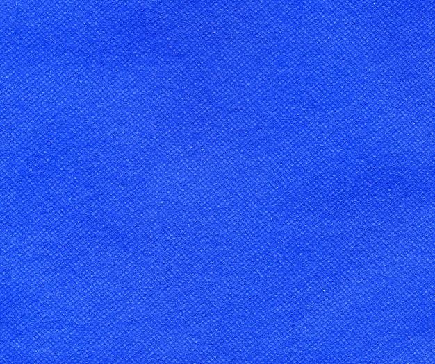 Blue nonwoven polypropylene fabric texture background