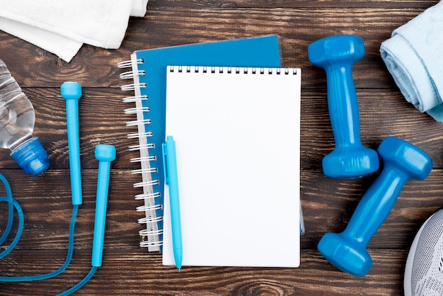 Blue notebook with dumbbells
