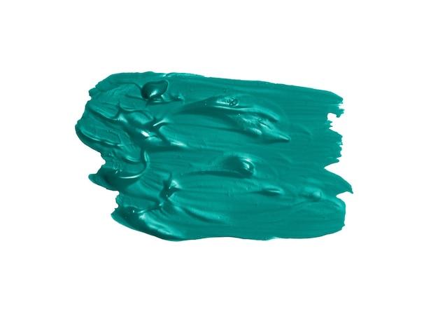 白い背景に分離された青い油絵の具の汚れ