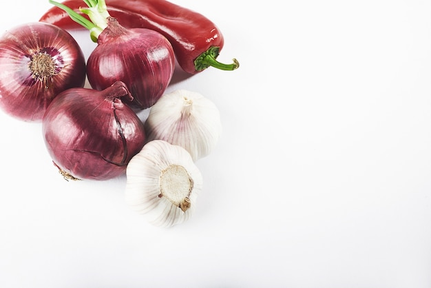 Blue onion garlic and hot red pepper isolated on white.