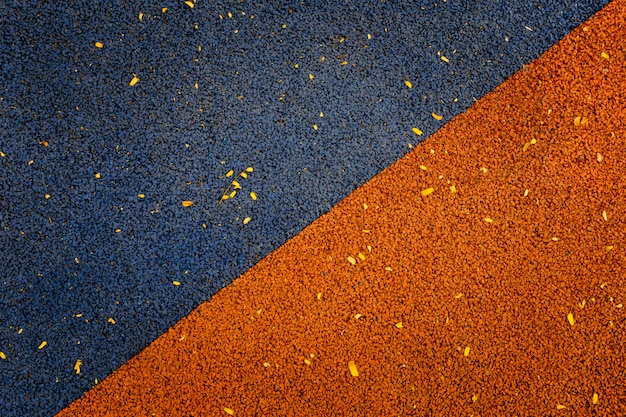 Blue and orange color of rubber flooring play park flooring background