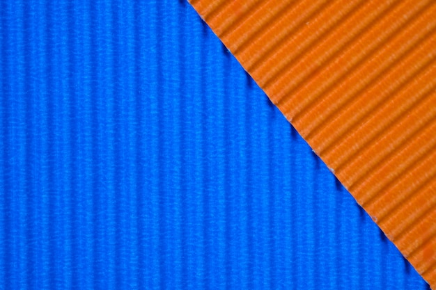 Blue and orange corrugated paper texture, use for background. vivid colour with empty space for add text or object.